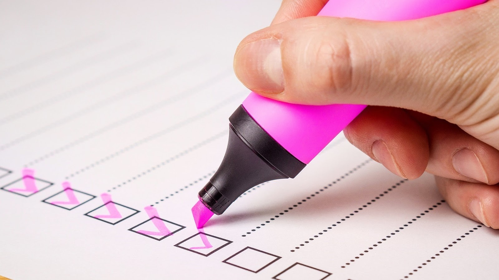 marker filling out a checklist