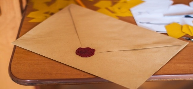 old letter with wax representing survey email invitation-656117-edited